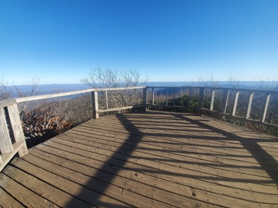 The wide deck of the platform on the Mount Pisgah Trail with a view of the mountains in the distance