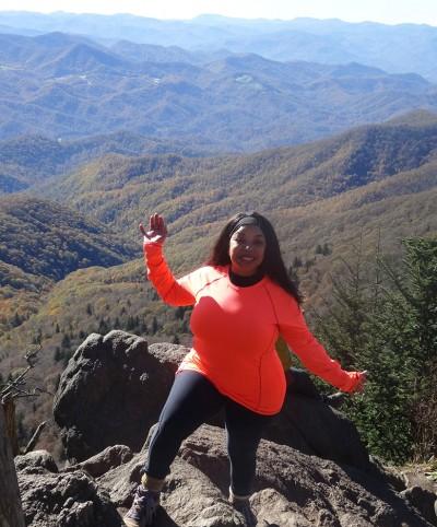 Tanya Marie Cummings atop a mountain peak along the Blue Ridge Parkway.