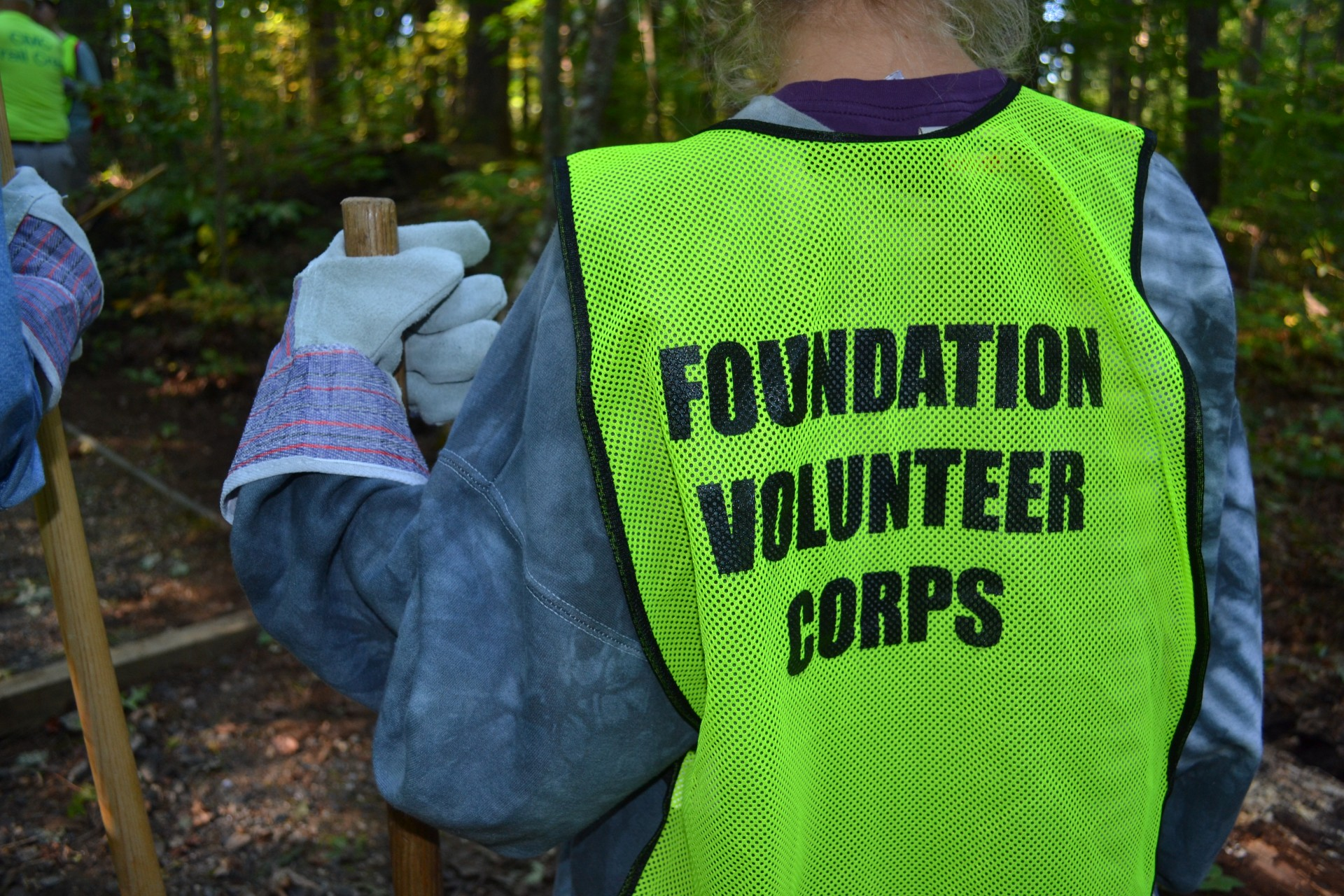 A volunteer in a corps safety vest