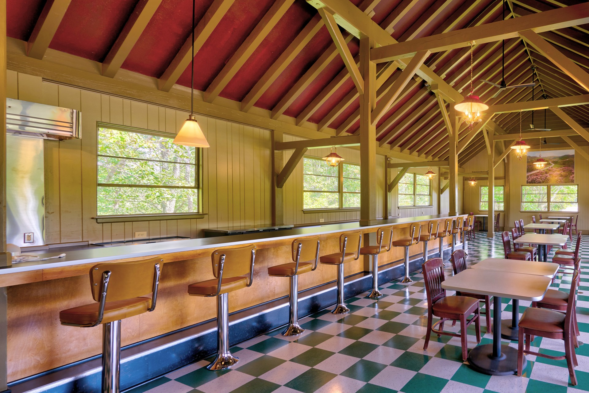 The Bluffs dining room with checkerboard floors and stools along a long lunch counter.