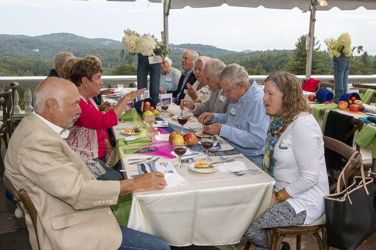 Guests enjoy dinner with a mountain view on the front drive at Flat Top Manor.