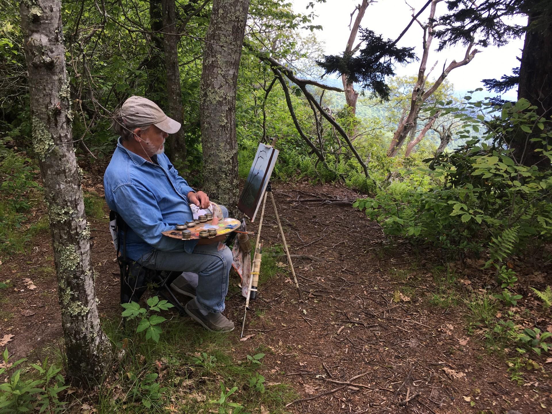 John Mac Kah painting in nature.